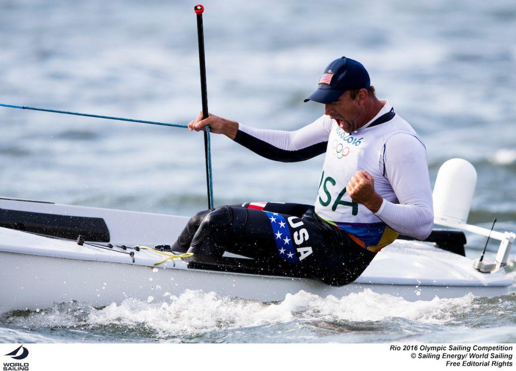 La gioia sfrenata dell'americano Caleb Paine dopo la conquista del bronzo, arrivata grazie alla vittoria nella Medal race finale. Foto Sailing Energy